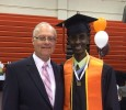 Bakar Ali pictured at a graduation ceremony with his mentor Jim Kurt